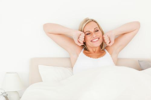 Woman waking up happy dental relief